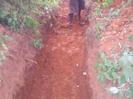 Excavating of soil in preparation of culvert