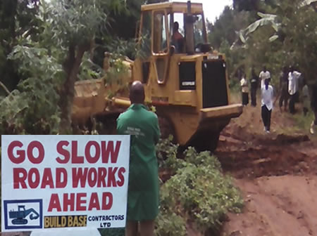 Road Signs with Grader on commissioning of Wakiso Project Works